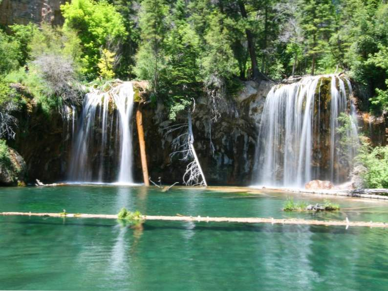 hanging lake trail in colorado leads to this breathtaking waterfall