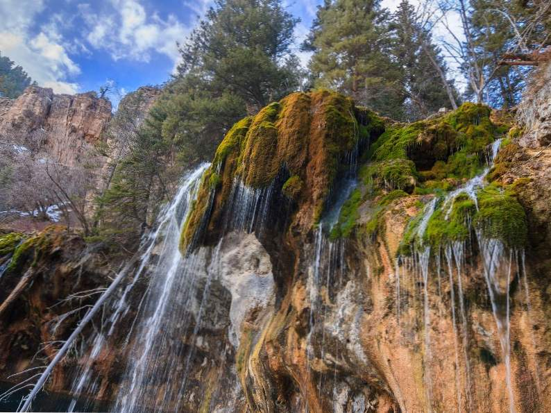 hanging lake trail in colorado leads to this breathtaking waterfall 2