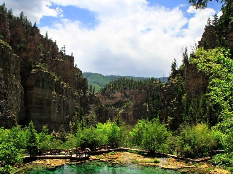 hanging lake trail in colorado leads to this breathtaking waterfall 3