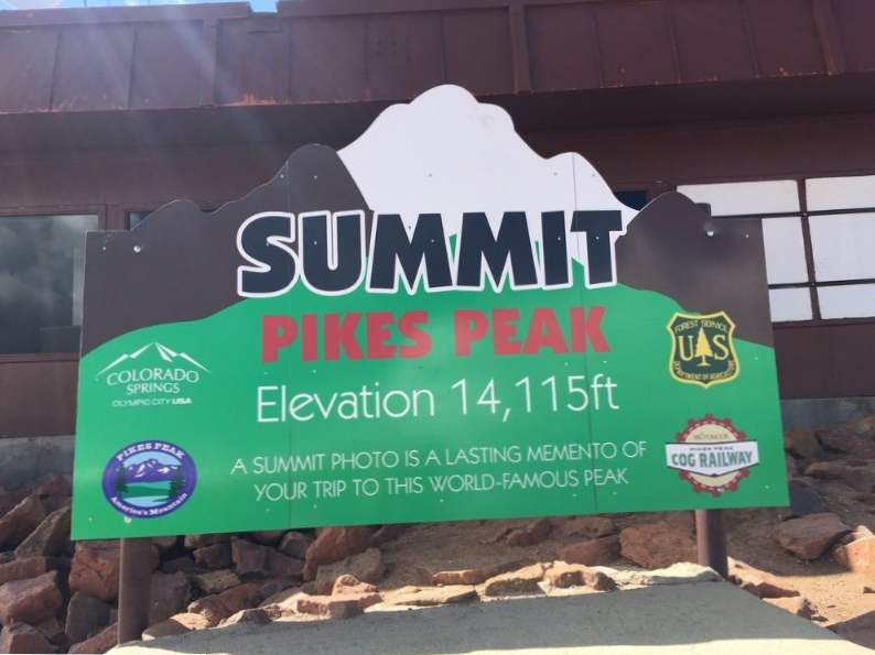 have a donut on one colorados tallest mountains at pikes peak summit house